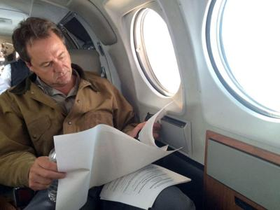 Governor Steve Bullock on board the governor's state-owned plane
