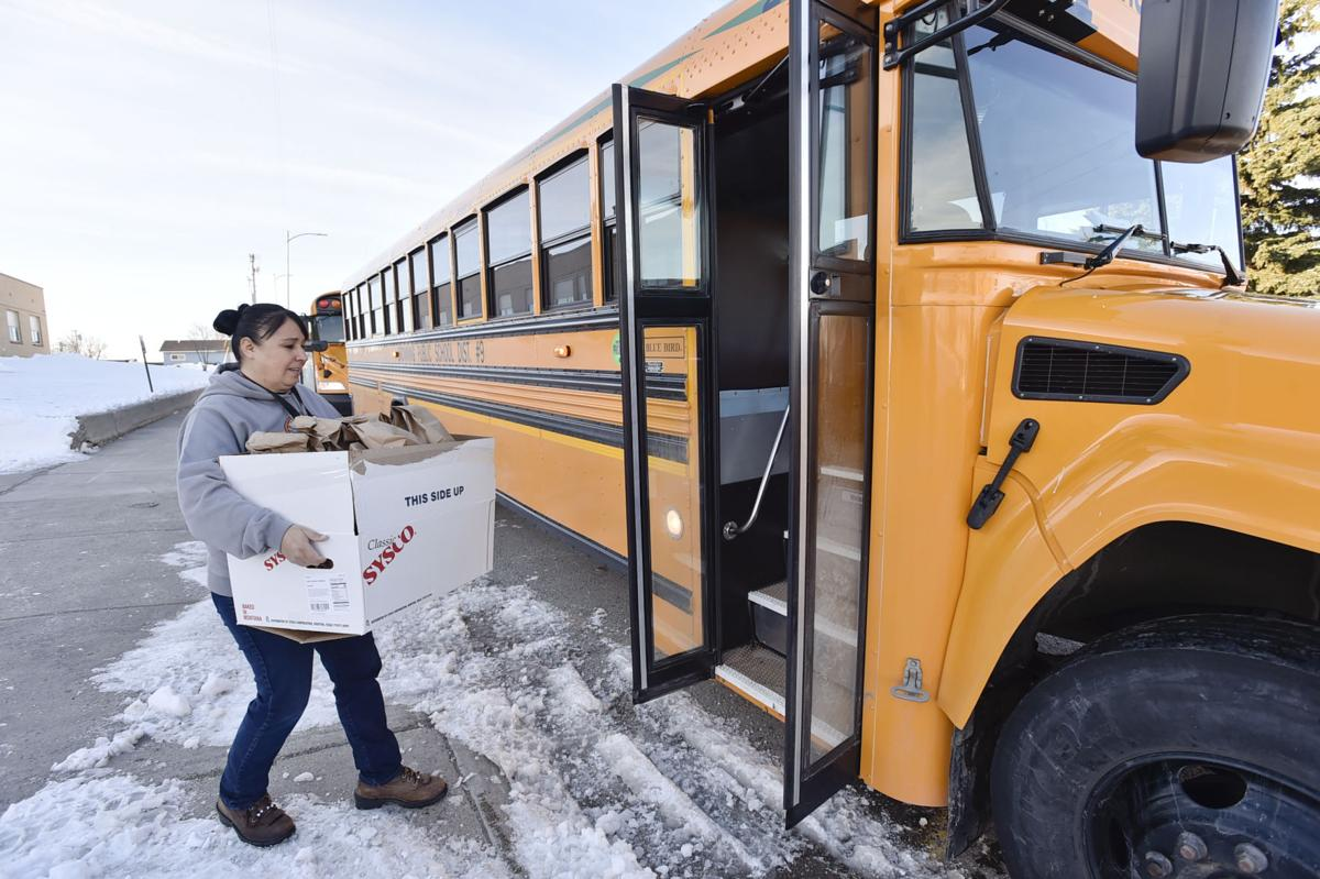 Bus driver Nicklo Crossguns hauls bag lunches