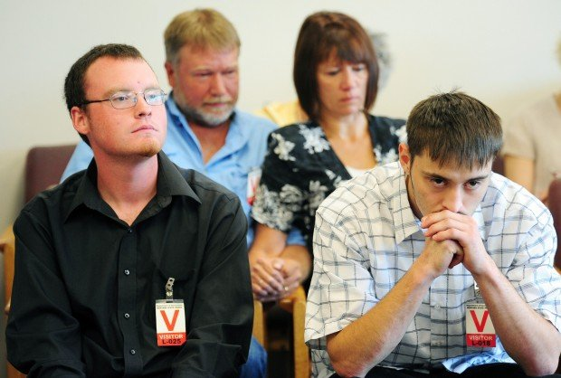 Joseph Wohlers, left, and Kahner Leary, right, listen