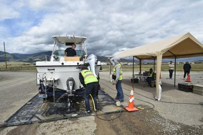 A boat from Wyoming is inspected and decontaminated at the Canyon Ferry decontamination station