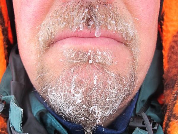 Snow turns a mustache and beard into a snotsicle