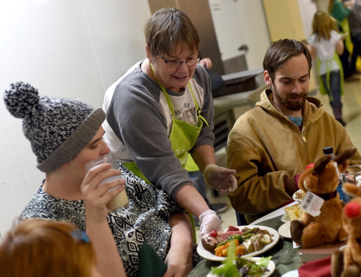 Jerri Fonner serves plates of food