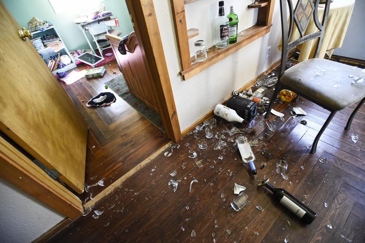 Bottles and antique glassware lay broken throughout Gordon Becker home east of Lincoln Thursday morning.