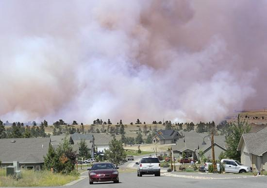Residents return home as crews battle fire north of Rehberg Ranch