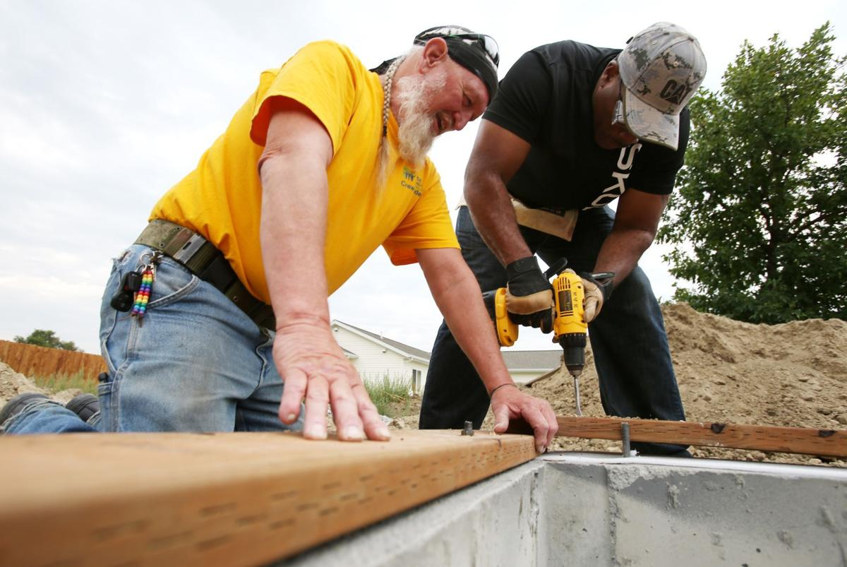 Habitat for Humanity crew leader Danny Glover and Commander Nathan Rowan