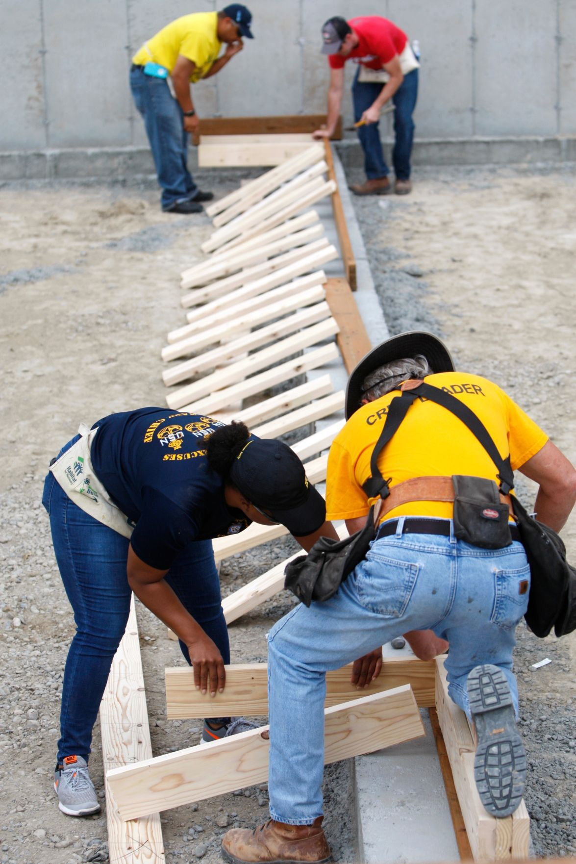 The crew of the USS Billings joins volunteers with Habitat for Humanity