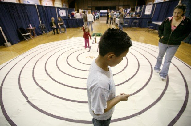 Roxanne Olson walks through the meditation labyrinth