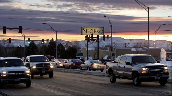 As the sun rises, cars make their way down King Avenue West