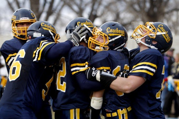 Miles City celebrates after a game-winning touchdown