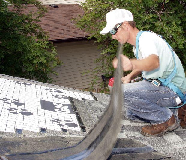Matt Ferguson works on a roof