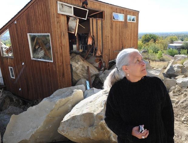 Homeowner surveys boulder destruction