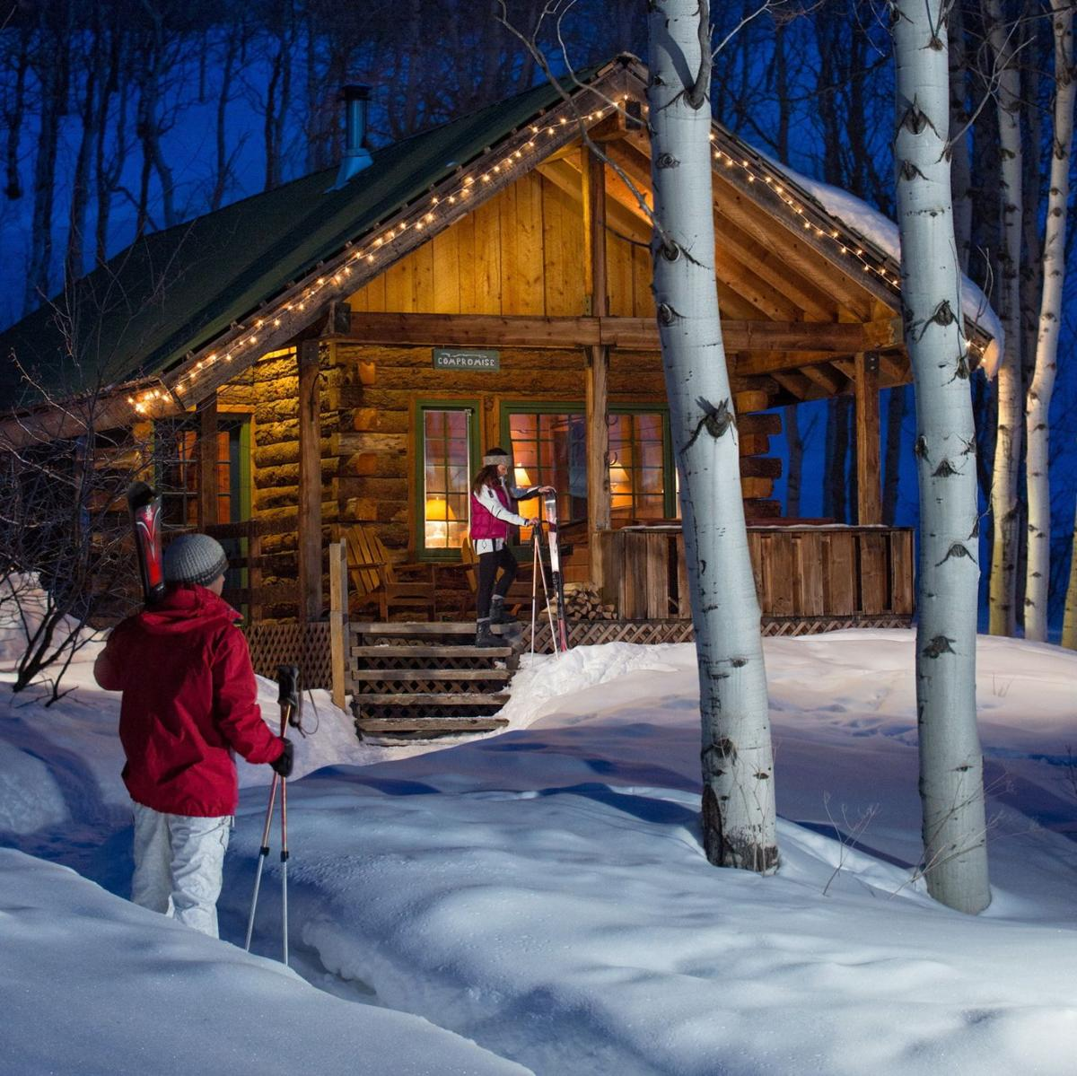 Cabins at the Home Ranch in Colorado are a festive home-away-from-home this holiday season.