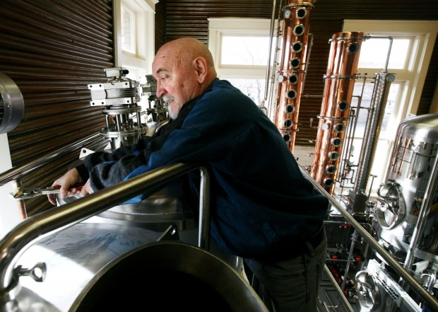 Lewis Harsanyi works on installing a still