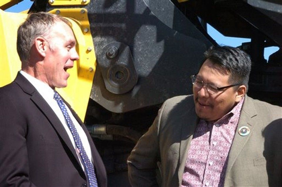 U.S. Rep. Ryan Zinke, left, laughs with Darrin Old Coyote