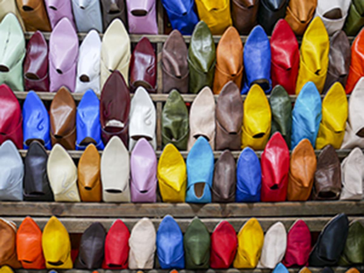 A stall specializes in selling colorful slippers called babouches in the ancient walled city in Fez.