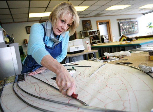 Susan Kennedy Sommerfeld works on a church window restoration