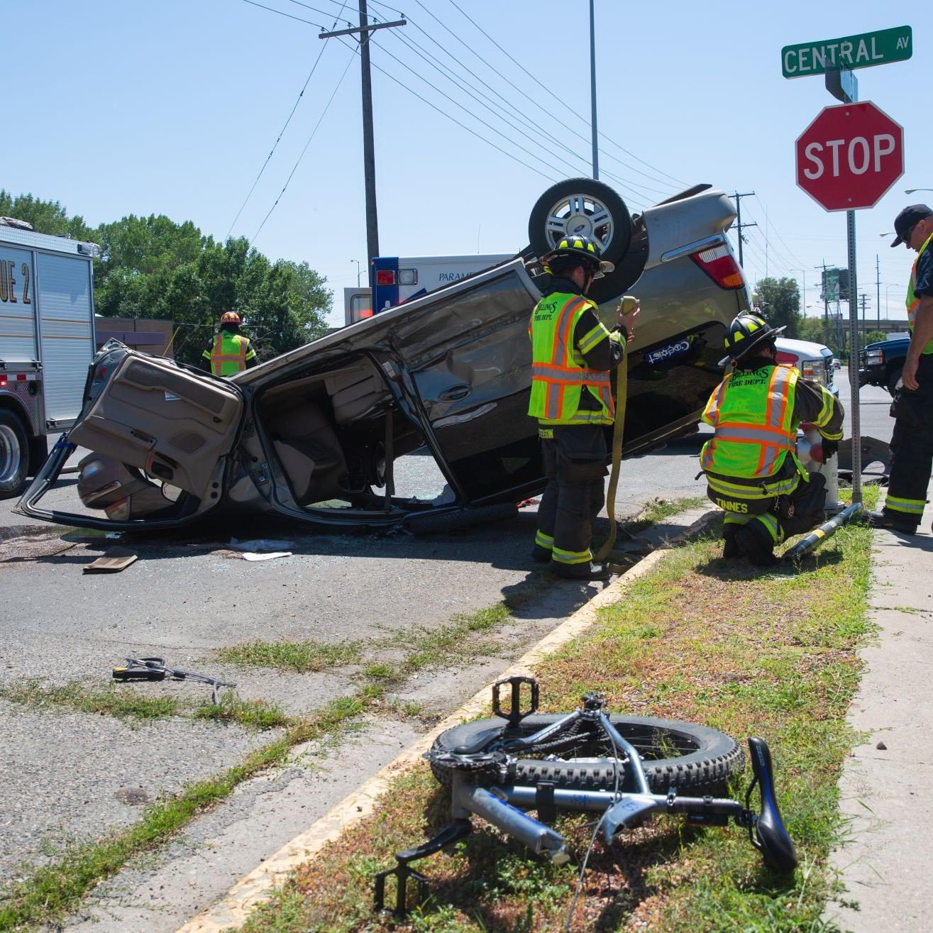 4 taken to hospital after minivan rollover pins bike on