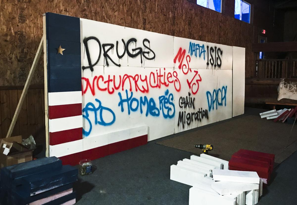 """At the annual Lincoln-Reagan dinner held by the Yellowstone County GOP in early March attendees could buy """"bricks"""" to erect a """"wall"""" that was covered in graffiti like """"DRUGS,"""" """"ISIS,"""" """"DACA,"""" """"JOBS"""" and """"HOMBRES."""""""