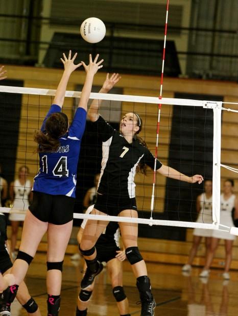 Katie Zink of West plays the net