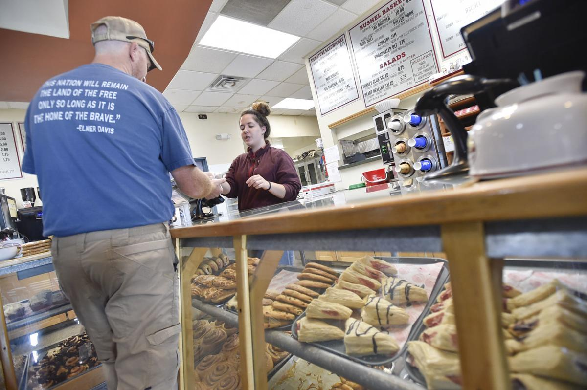 A customer pays for lunch in the Wheat Montana deli
