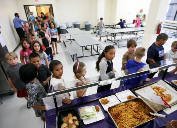 Third-graders line up for lunch