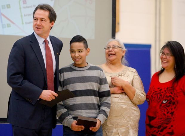 Steve Bullock presents an award to Joseph Little Eagle