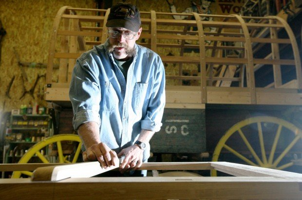 Jem Blueher works on a wagon