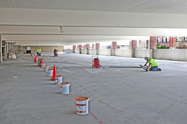 Workers prepare to paint