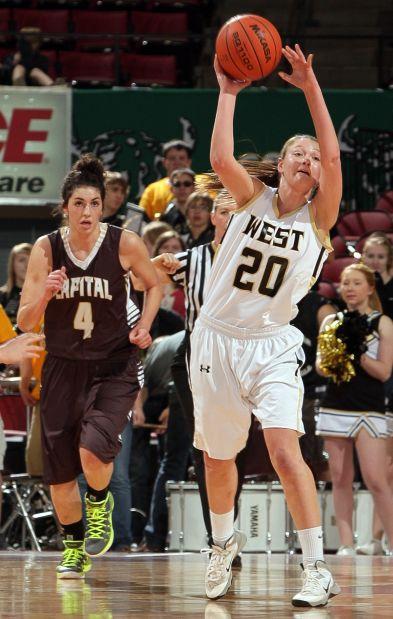 Billings West's Jessi Zuroff (20) passes