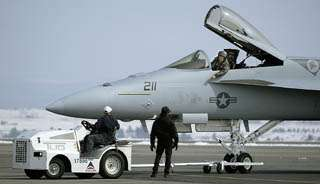 Disabled F-18 fighter aircraft fixed at Logan