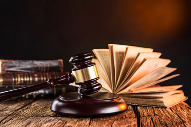 Wooden gavel and books law judgement stockimage pages