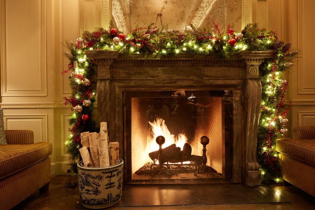 """Holiday decorations are available around in-room wood-burning fireplaces with The Lowell's """"Very Lowell Holiday"""" package."""