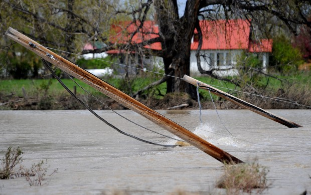 Phone lines hang in the Musselshell River