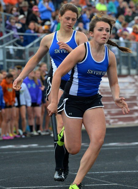Billings Skyview Haley Gellner takes the baton from Shea Wacaser