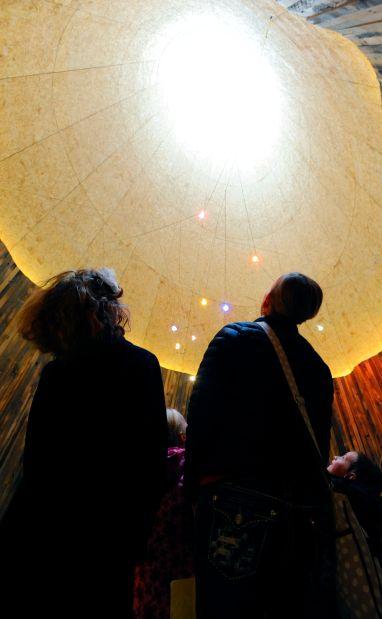 Visitors stare into a skylight