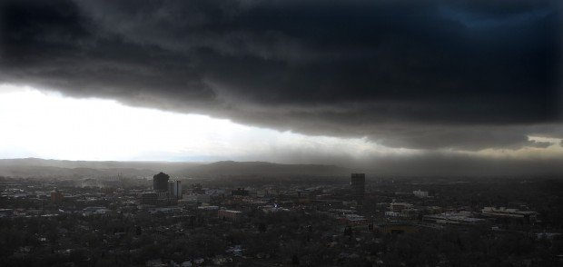 A storm packing wind, ice pellets, snow and lightning rolls over Billings