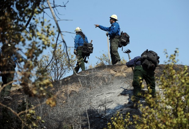 Members of the Bighorn Initial Attack crew search for hotspots