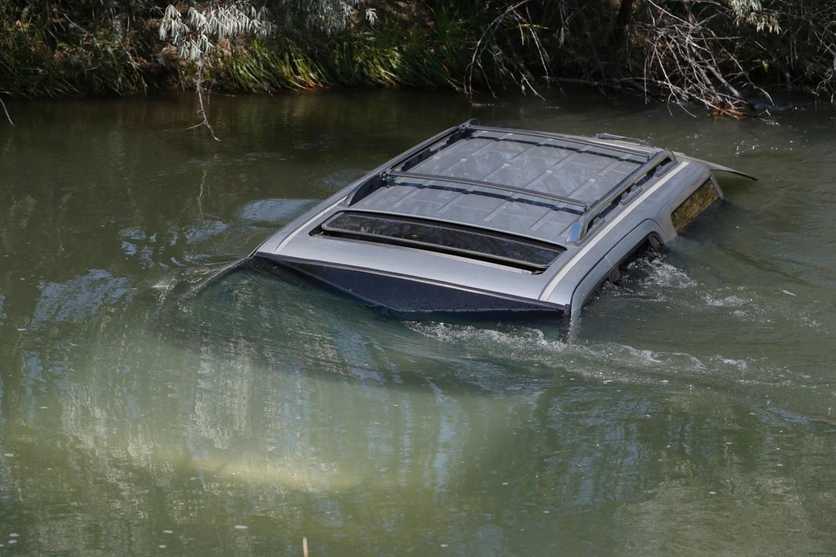 SUV in canal