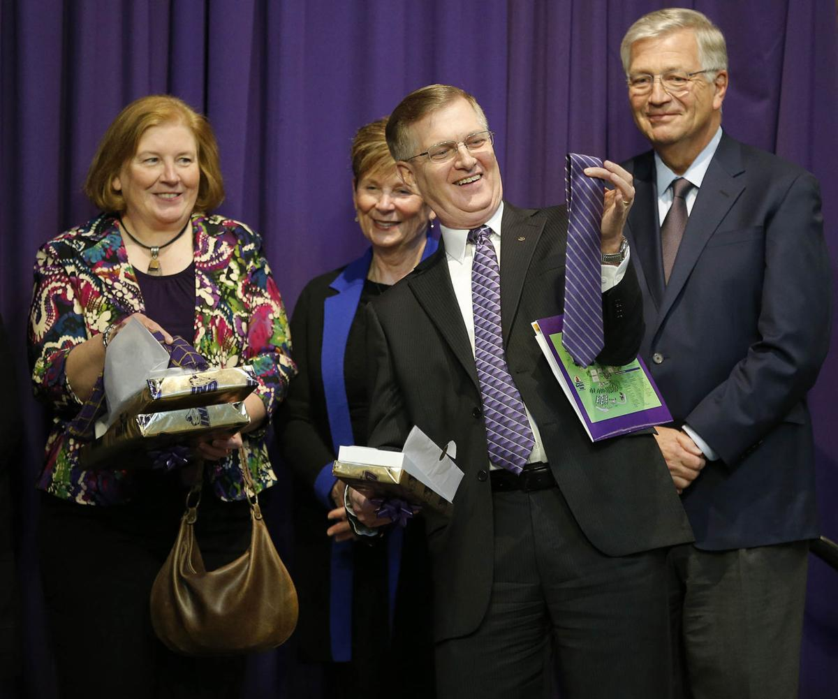Mark Nook accepts a gift of a purple tie