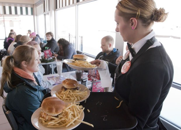 Cassie Burling serves up burgers and fries