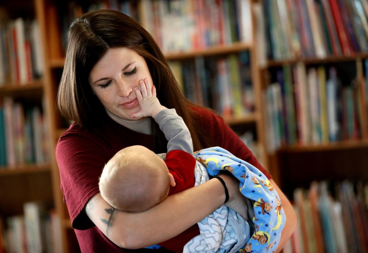 Jennifer Birkoski holds her infant son, Honor