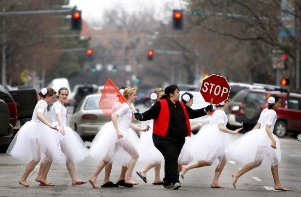 Dancers cross Third Avenue North