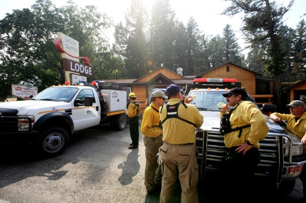 Firefighters gather in front of the Pine Creek Cafe