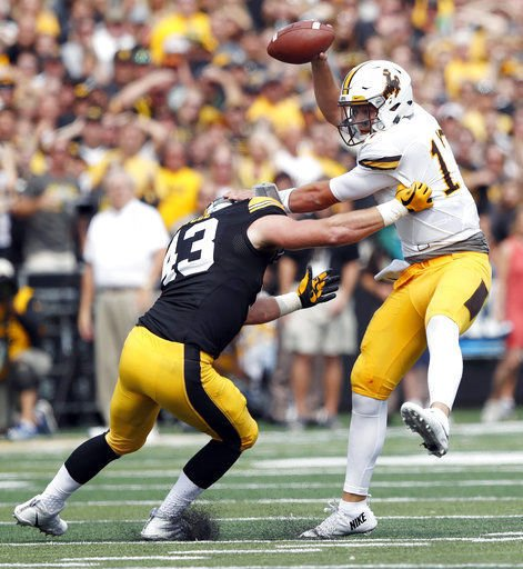 Swing and a miss! Wyoming punter completely misses a kick versus Iowa