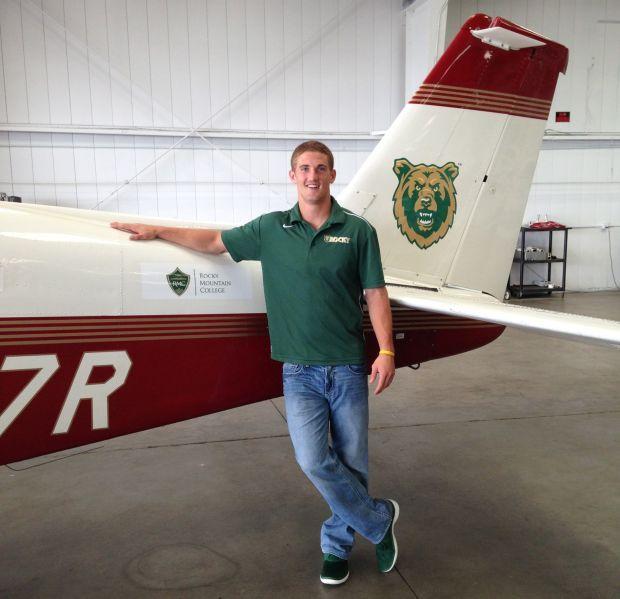 Cole Cattelan poses alongside a Beechcraft Bonanza