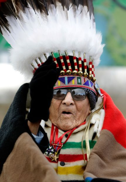 Joseph Medicine Crow waves