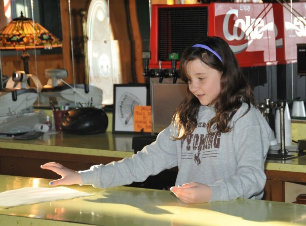 McKinsey Conner, 10, helps her mother out behind the counter