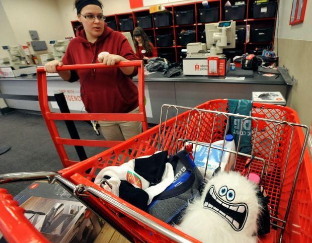 A Target employee restocks items