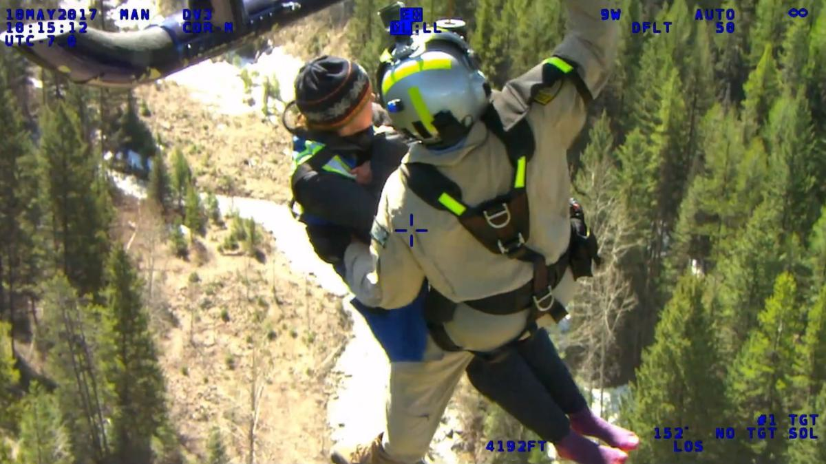A screenshot taken from a video of the rescue of Madeline Connelly, a 23-year-old