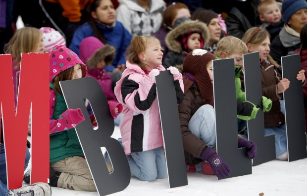 """Children hold letters spelling out """"I Am Billings"""""""